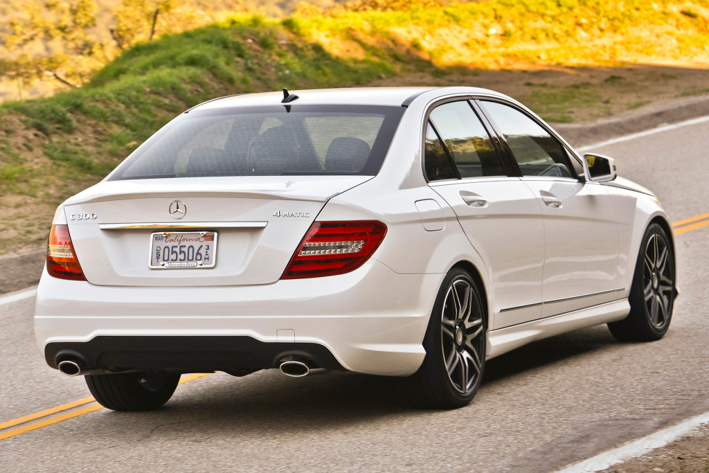 2013-mercedes-benz-c300-4matic-rear-passengers-three-quarters-view-in-motion